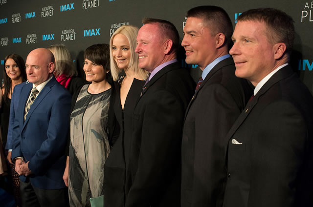 "Jennifer Lawrence (center), with astronauts Scott Kelly, Samantha Cristoforetti, Butch Wilmore, Kjell Lindgren and Terry Virts as seen at the IMAX premiere of ""A Beautiful Planet."" (NASA/Joel Kowsky)"